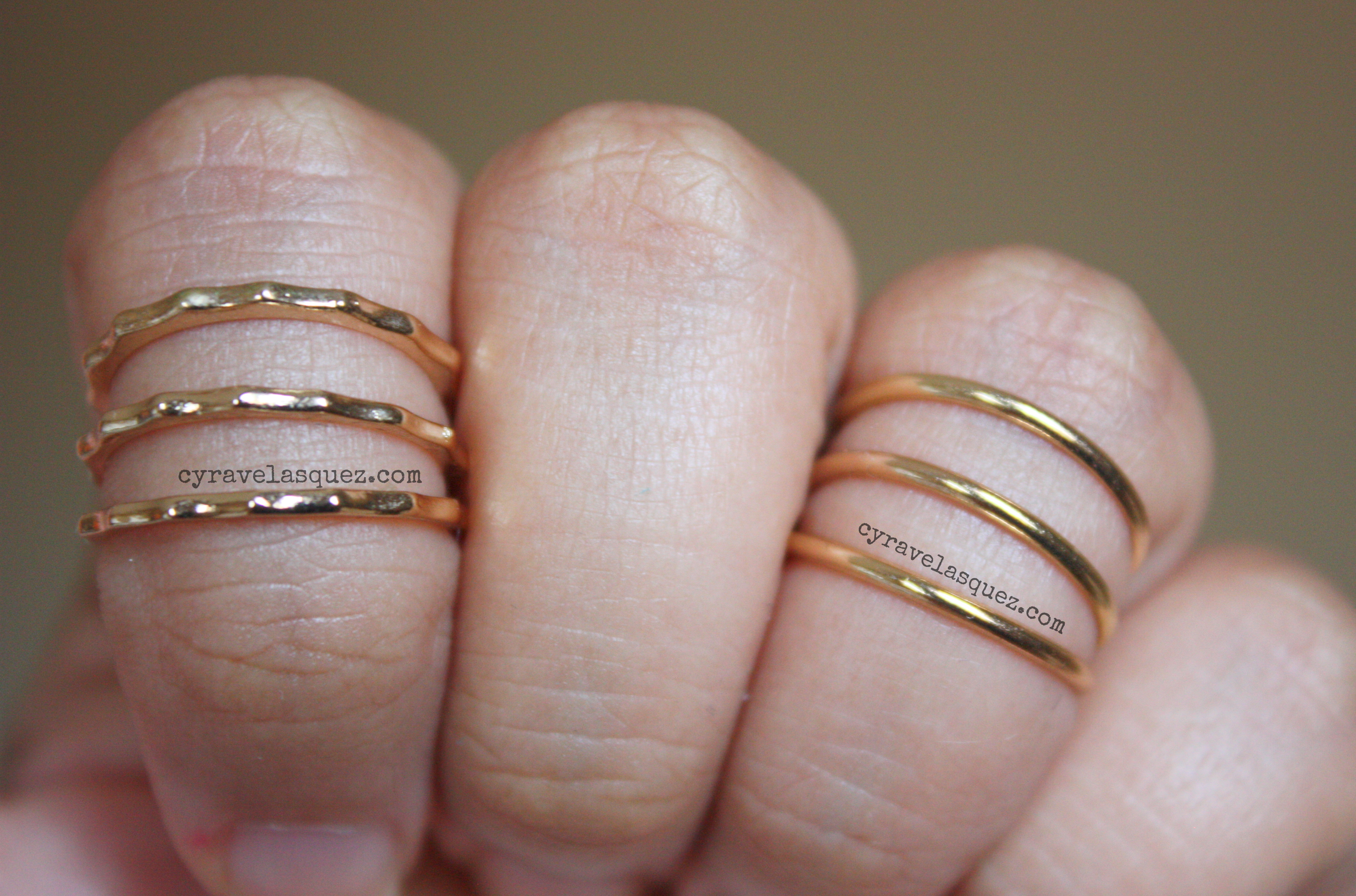 Gold knuckle rings and middy rings worn by Cyra Velasquez.
