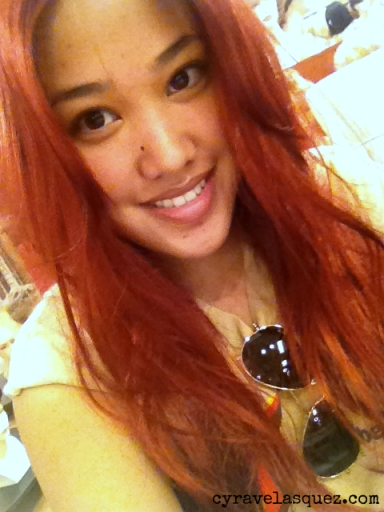 Cyra Velasquez with red hair.