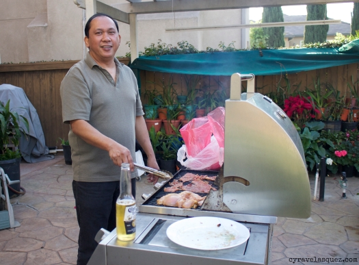 Jim Velasquez grilling carne asada and chicken.