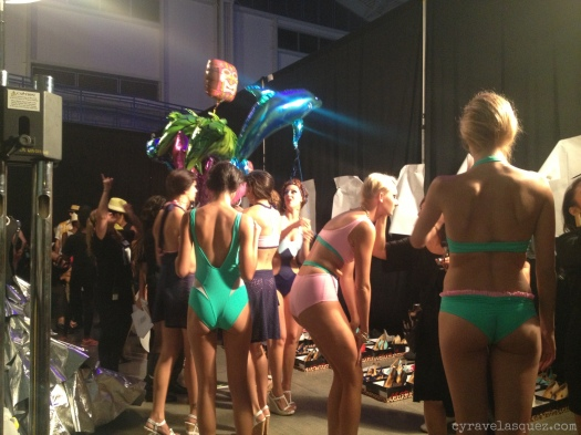 Cyra Velasquez backstage with Dos Caras Swimwear models at Fashion Week San Diego (FWSD).