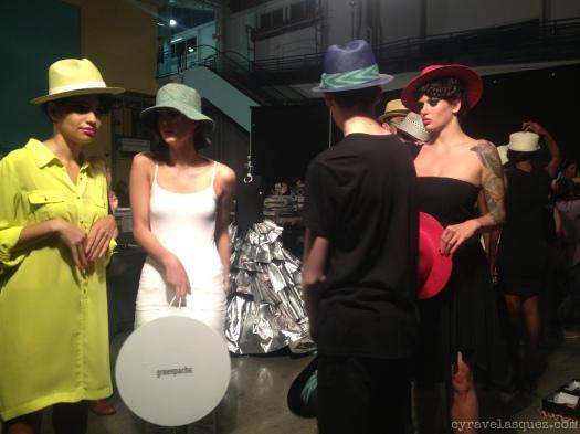 Cyra Velasquez backstage with Greenpacha hat models at Fashion Week San Diego (FWSD).