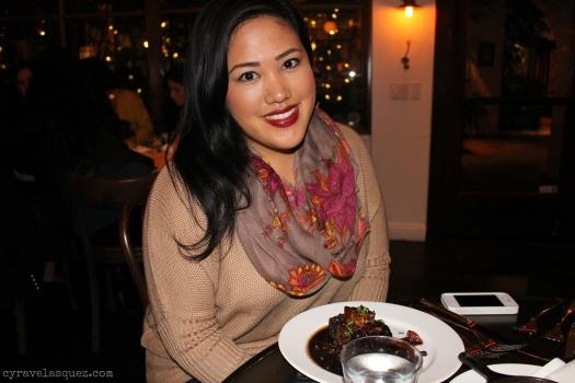 Cyra Velasquez eating braised short ribs from The Hake restaurant in La Jolla in San Diego, California.