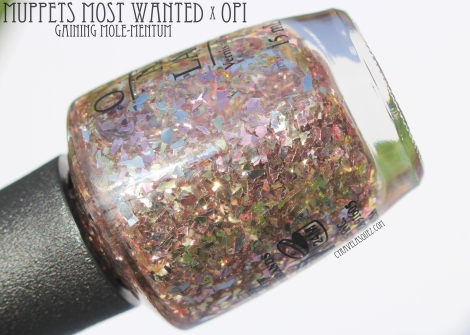 Gaining Mole-Mentum nail polish from OPI's Muppets Most Wanted collection.